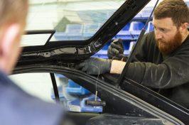 technicians replacing a windscreen